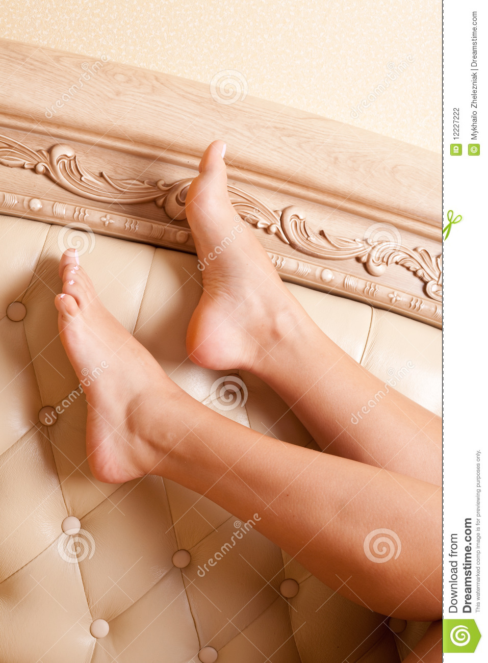 Women's feet on the background of beautiful furniture.