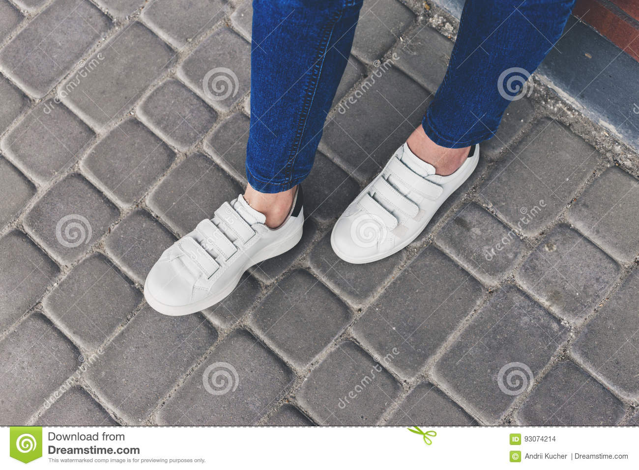 Women S Feet In Blue Jeans And White Sneakers Stock Photo Image Of