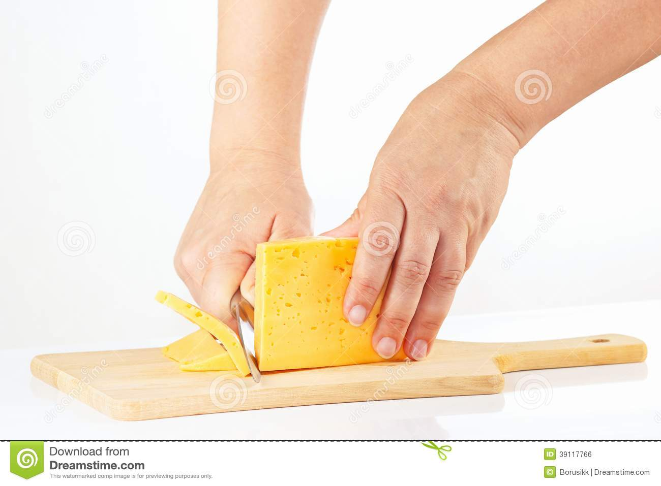 womens hand with a knife sliced cheese stock photo