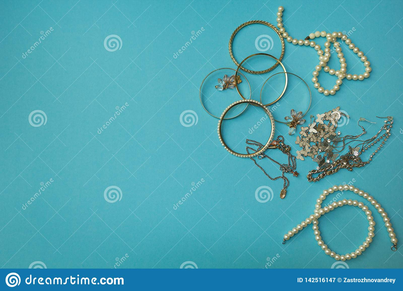 Women`s jewelry and other stuff on a blue background