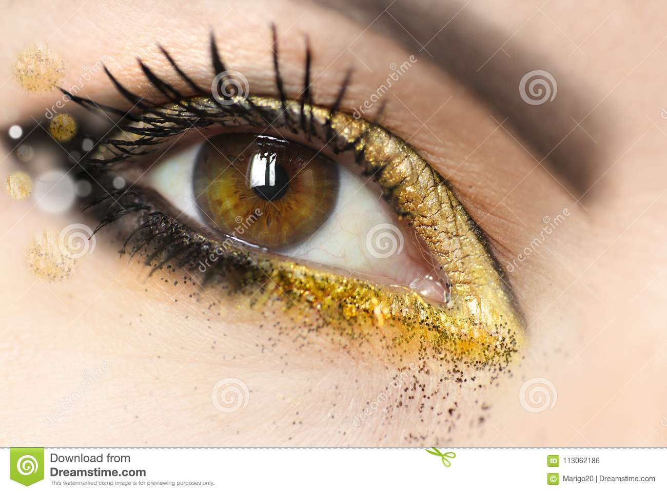 Womens Makeup Brown Green Eyes With Gold Eye Shadow Stock Photo