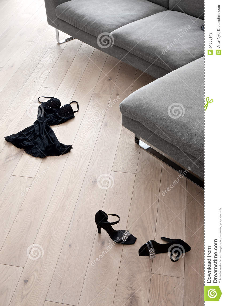 Women S Shoes And Clothes Lying In Front Of A Sofa Stock