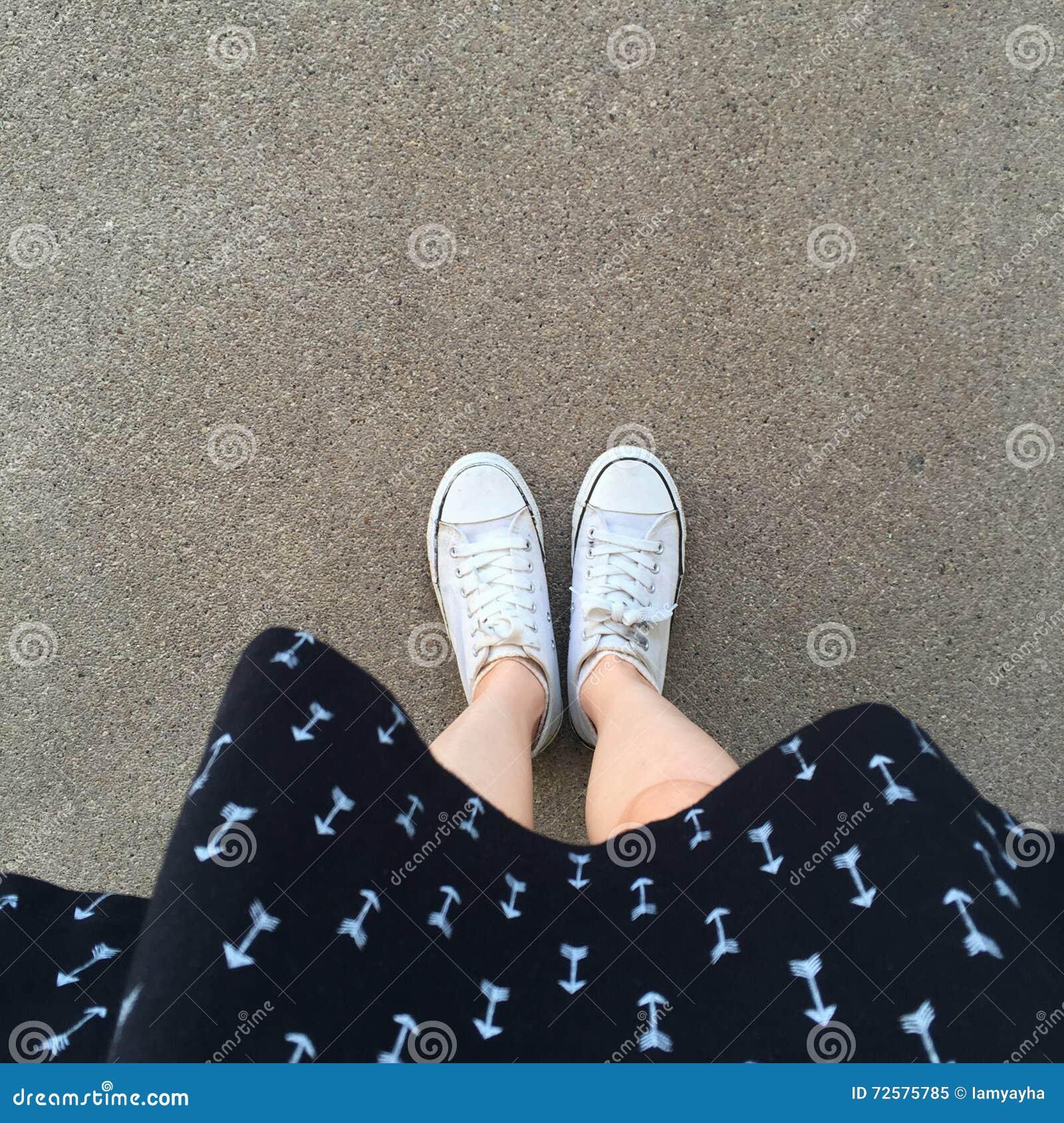 Women s white gumshoes. White dress. Warm season style for women. Practical fabric shoes