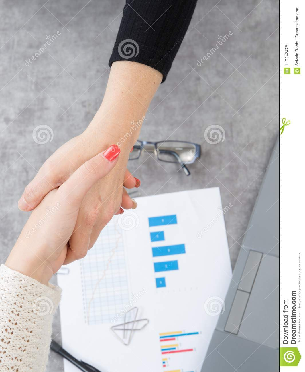 Women Shake Hands Over The Desk After Entering Into A Commercial