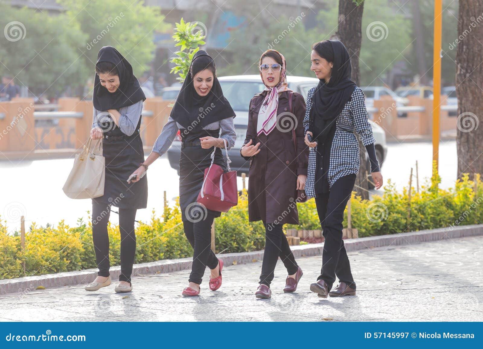 SHIRAZ, IRAN - APRIL 25, 2015: unidentified women walking in Shiraz ...