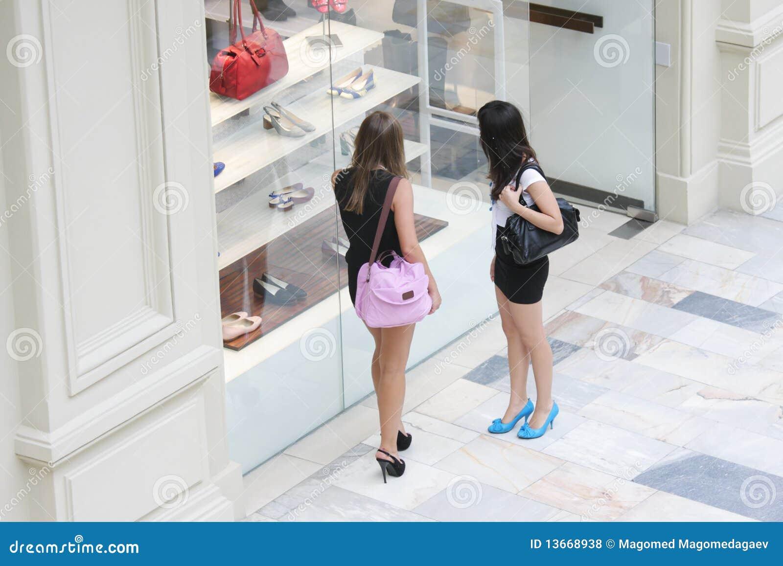 Royalty Free Stock Photos: Women at shoe shop window