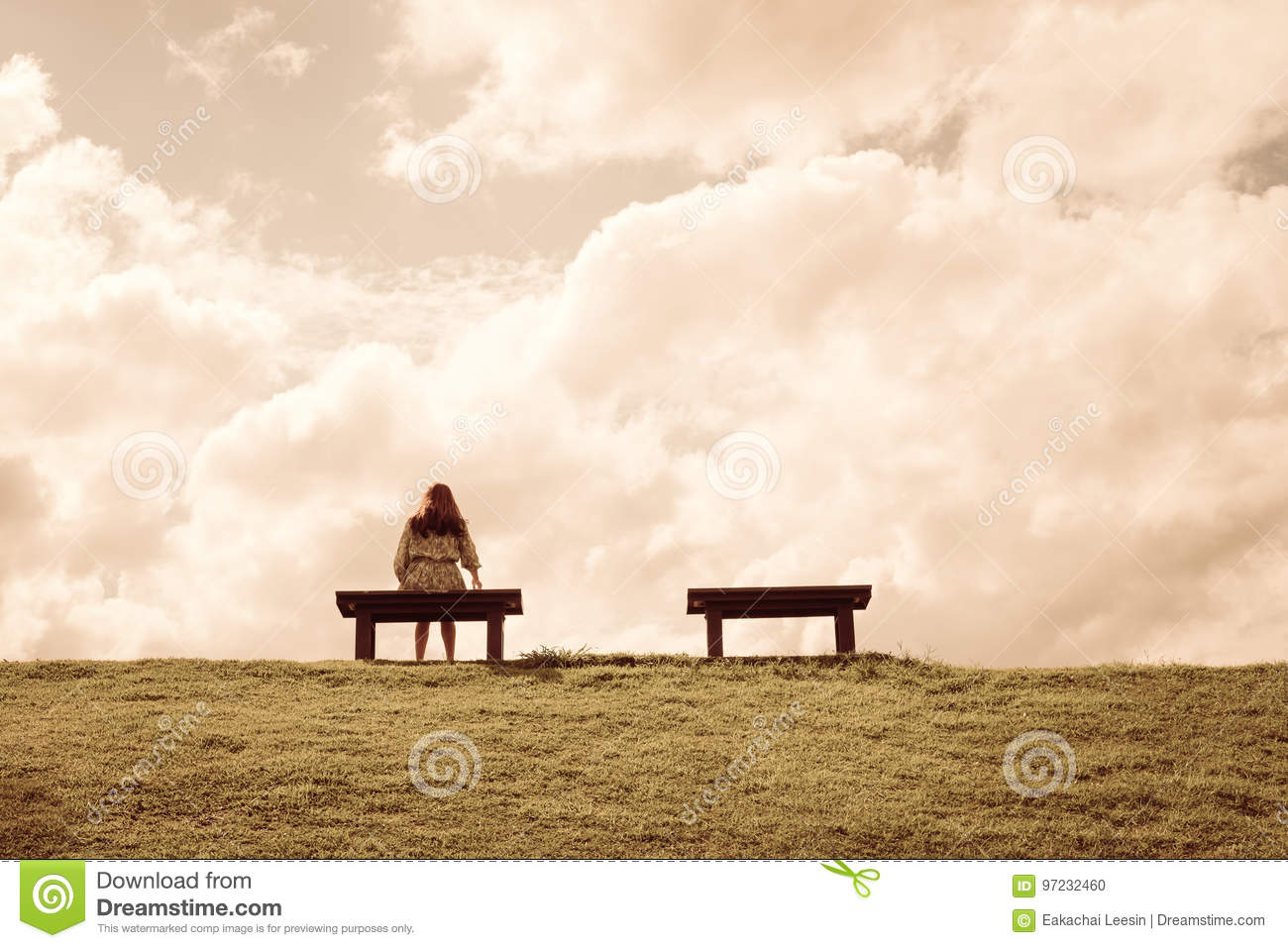 A Women Sitting Alone On A Bench Waiting For Love Stock Photo