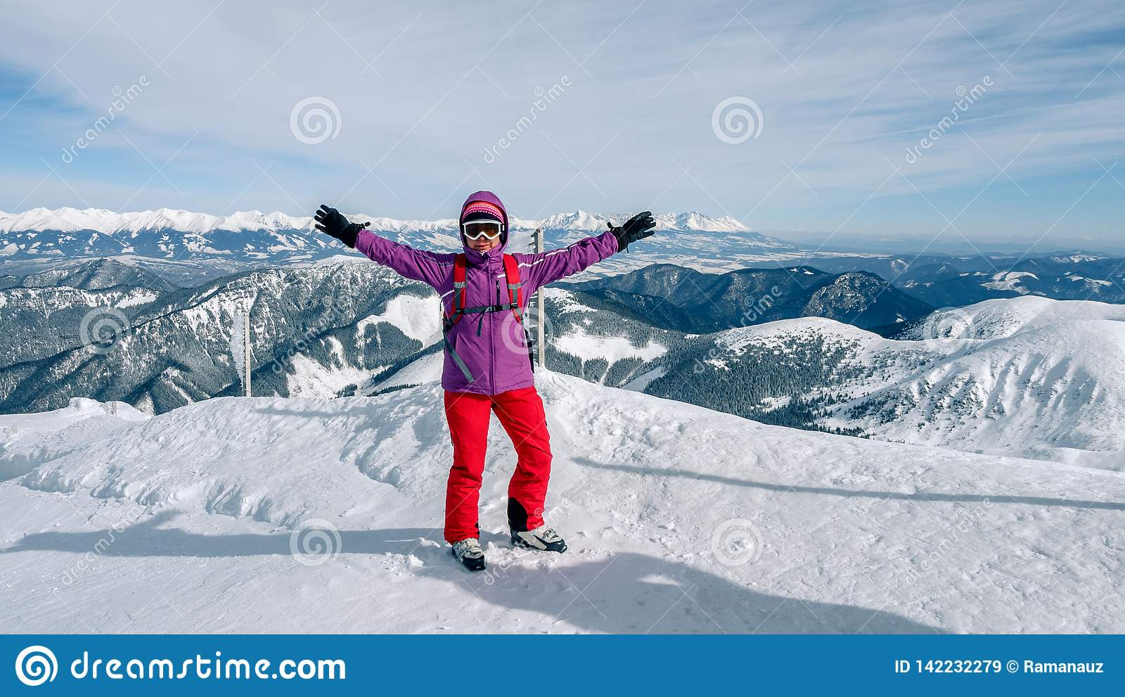 Women skier finding the best track. Skier looking down to the valley. Waiting for right moment. Best choice. Chopok, Low Tatras,
