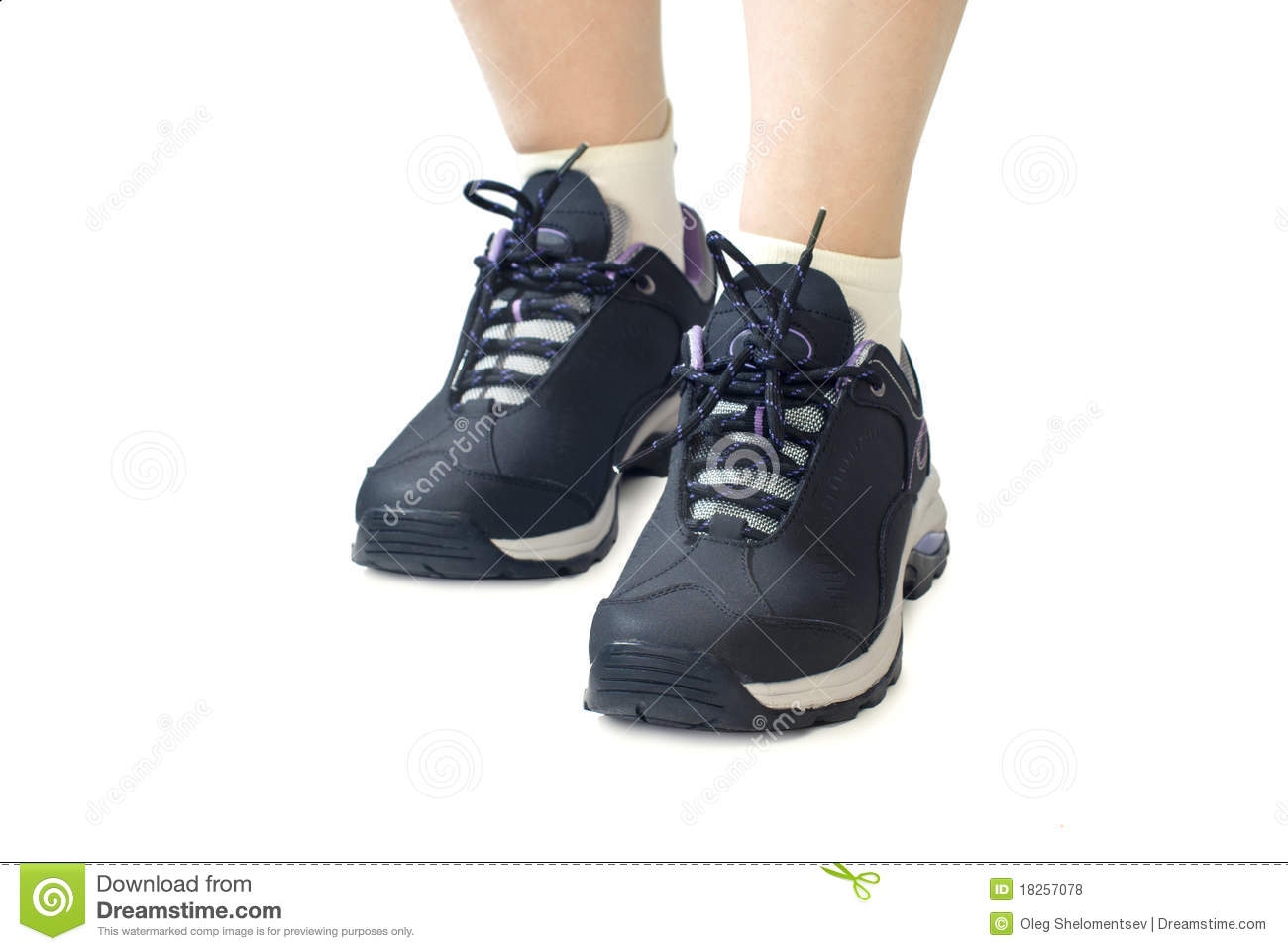 Women sports shoes / sneakers. Closeup of woman legs and feet wearing