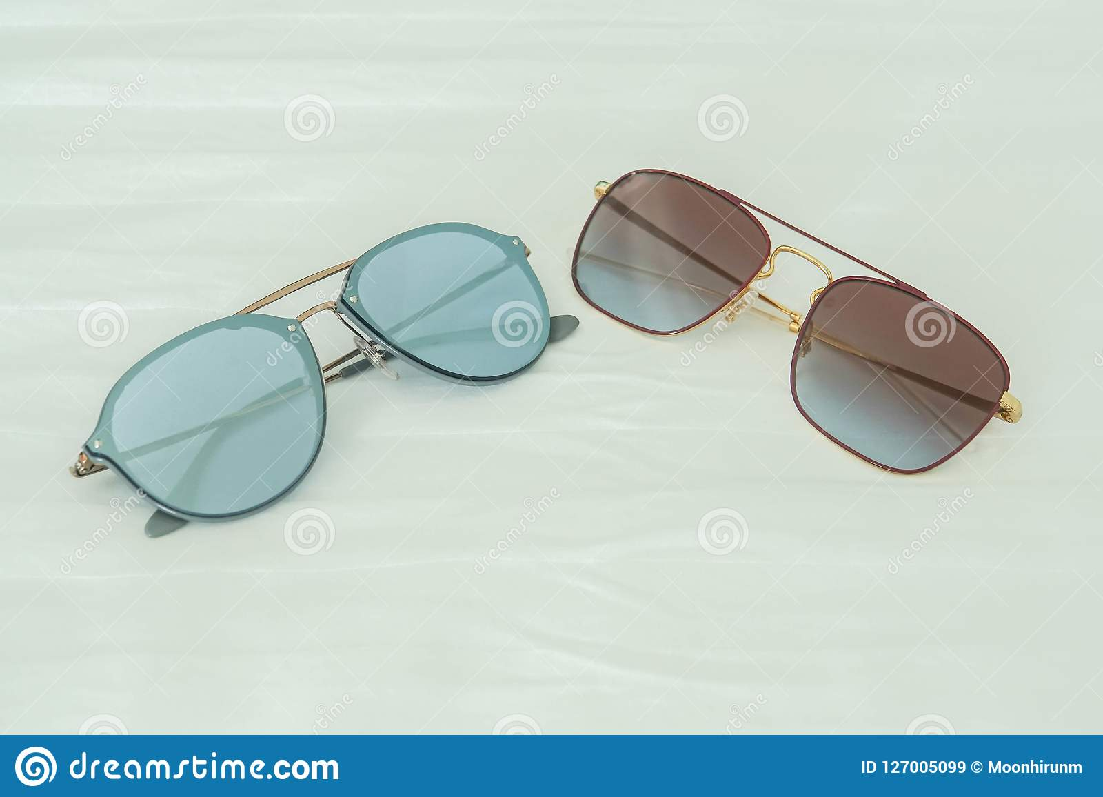 Women sunglasses in blue and deep pink for wearing in outdoors activities in holidays