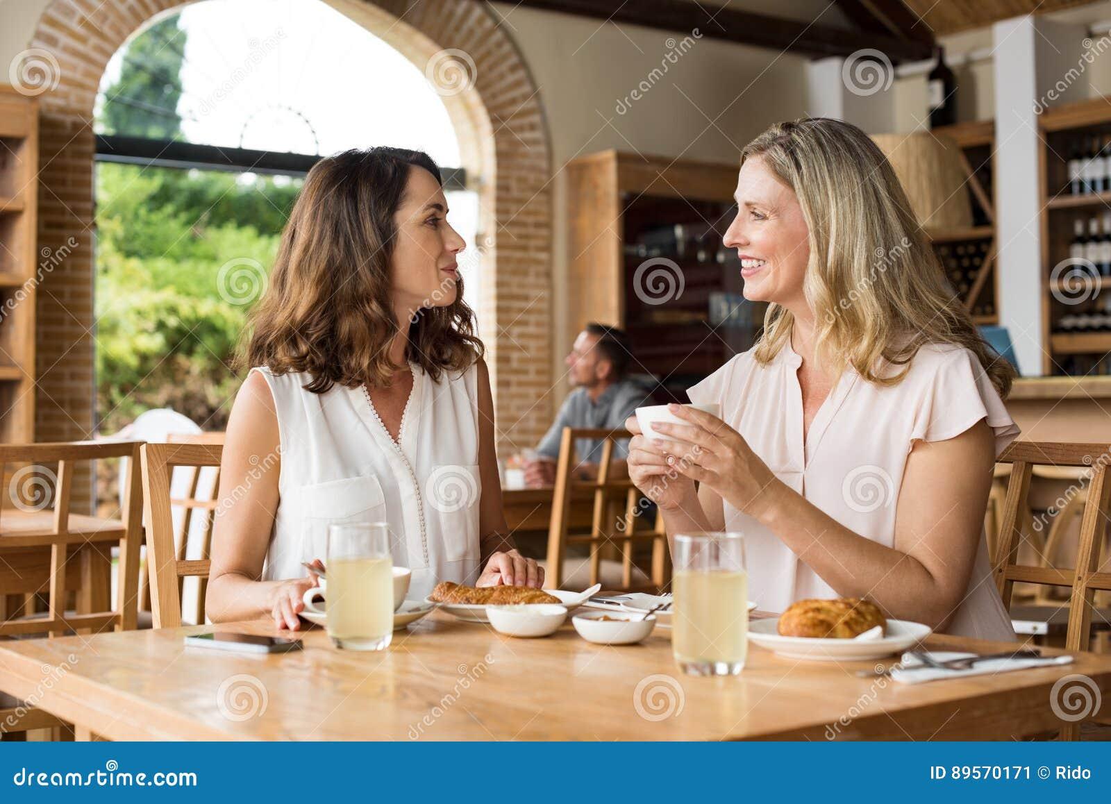 Women talking over coffee