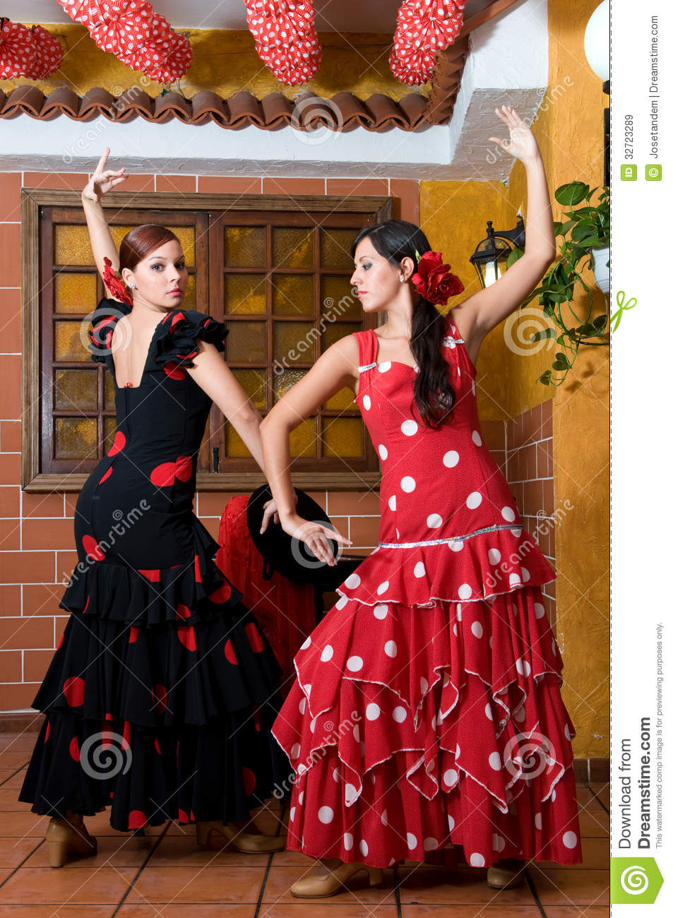 women in traditional flamenco dresses dance during the. Black Bedroom Furniture Sets. Home Design Ideas