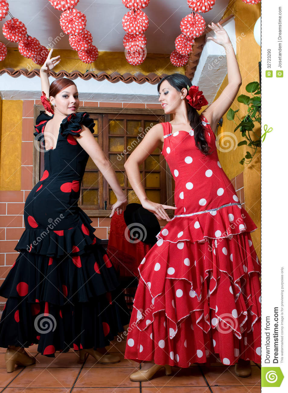 Women In Traditional Flamenco Dresses Dance During The