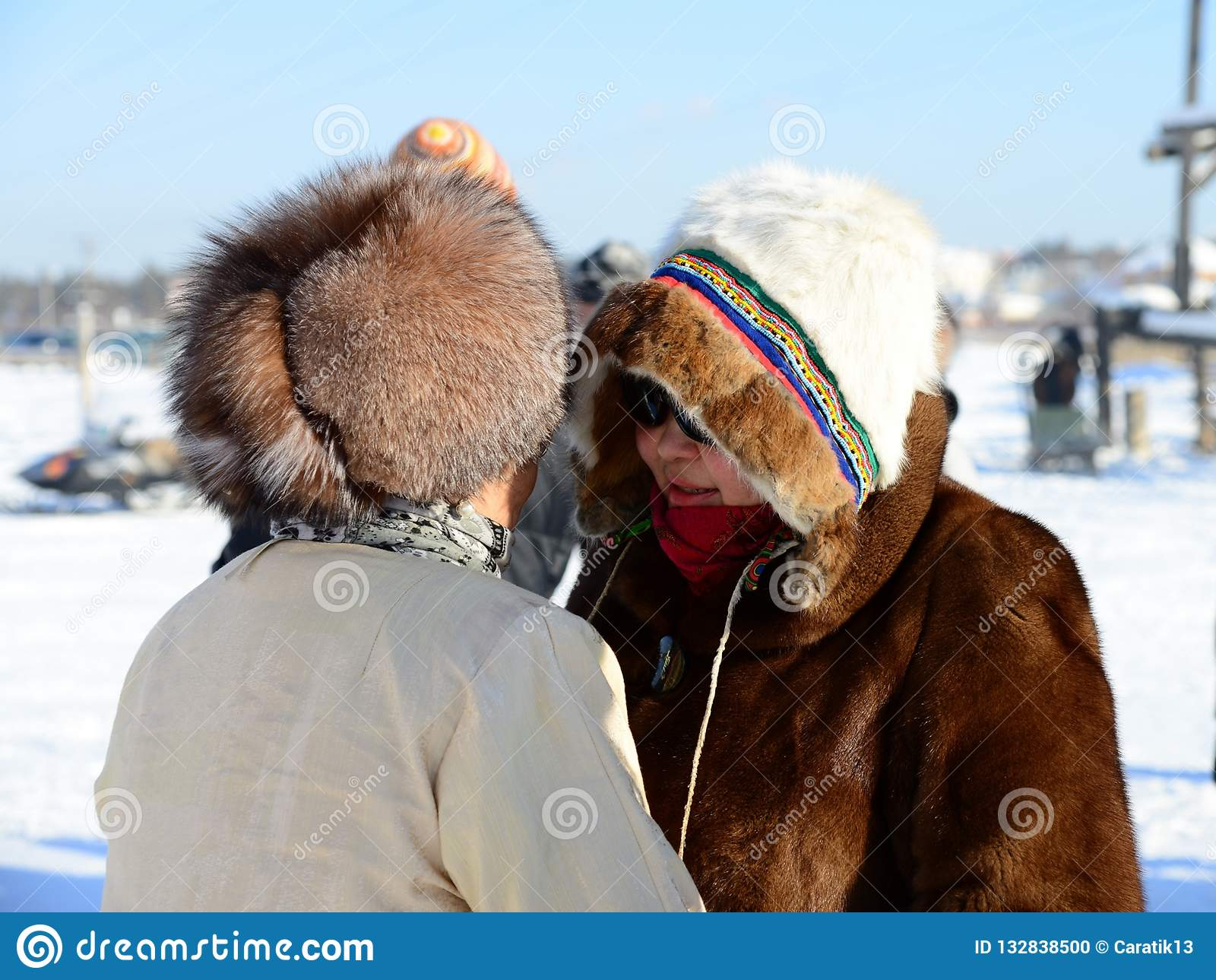8c2f56bddaa63 Yakutsk, Republic of Sakha Yakutia/Russia-March 01 2015: women in traditional  clothes and fur hats talking to each other