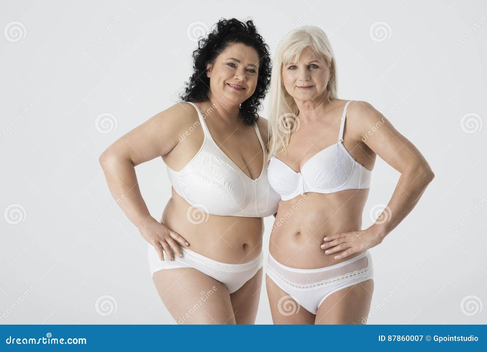 Two mature women in black lingerie
