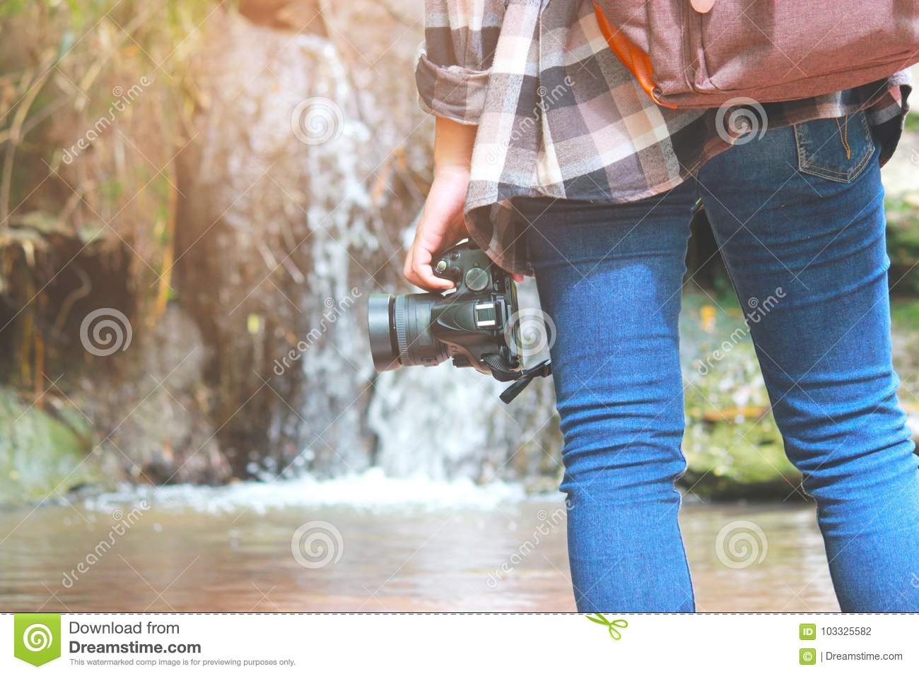 eb78f4dea4eb A women Walking with jeans and sneaker shoes and Waterfall background