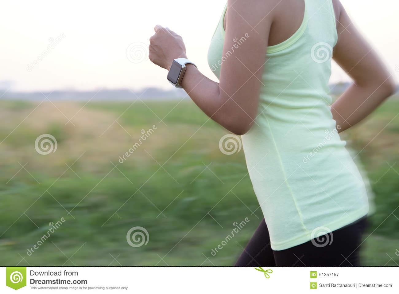 Women wear hand watch running motion blur concept