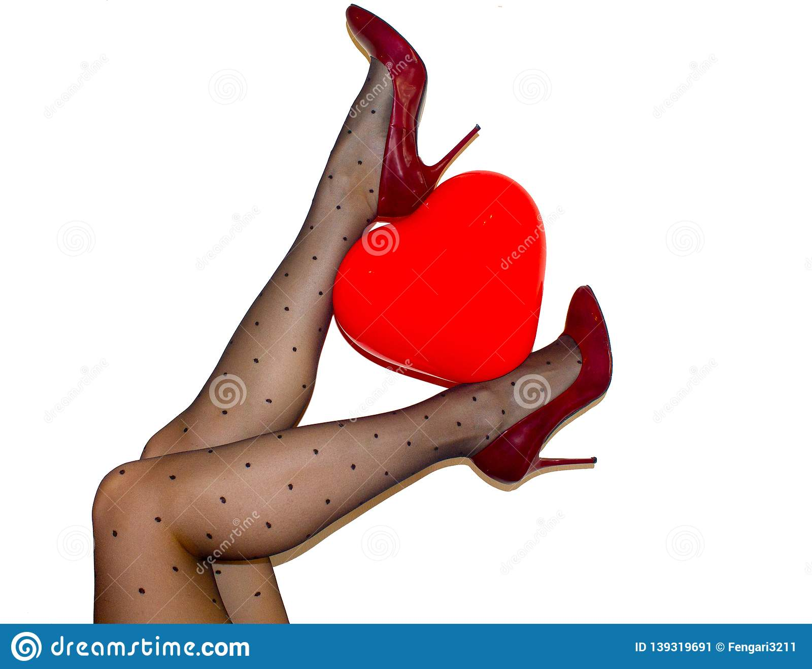 88b3d71c14ab0 Womens legs in black tights and maroon high heel shoes holding red heart  ballon on white background