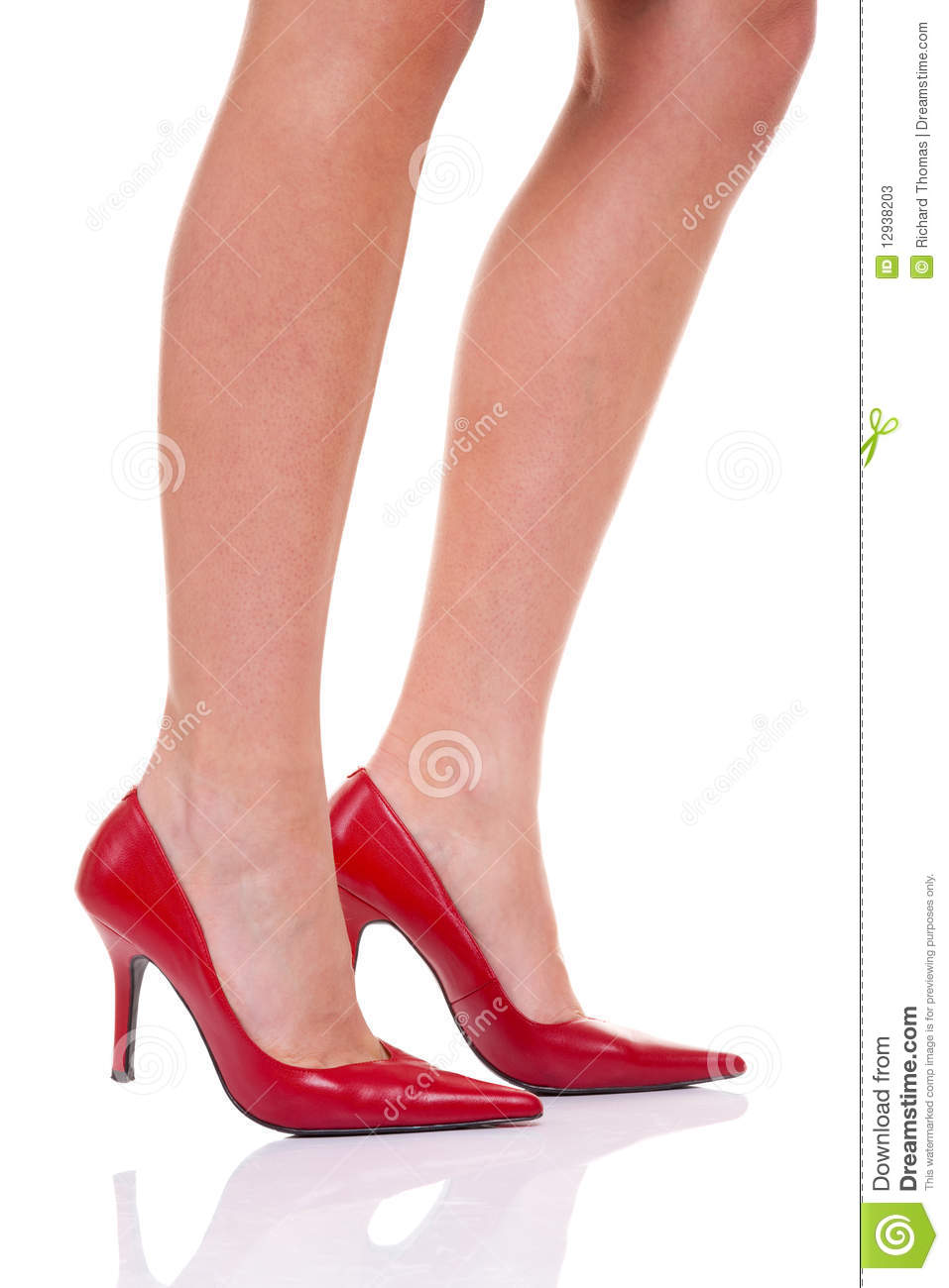 womans legs with red high heeled shoes, isolated on a white