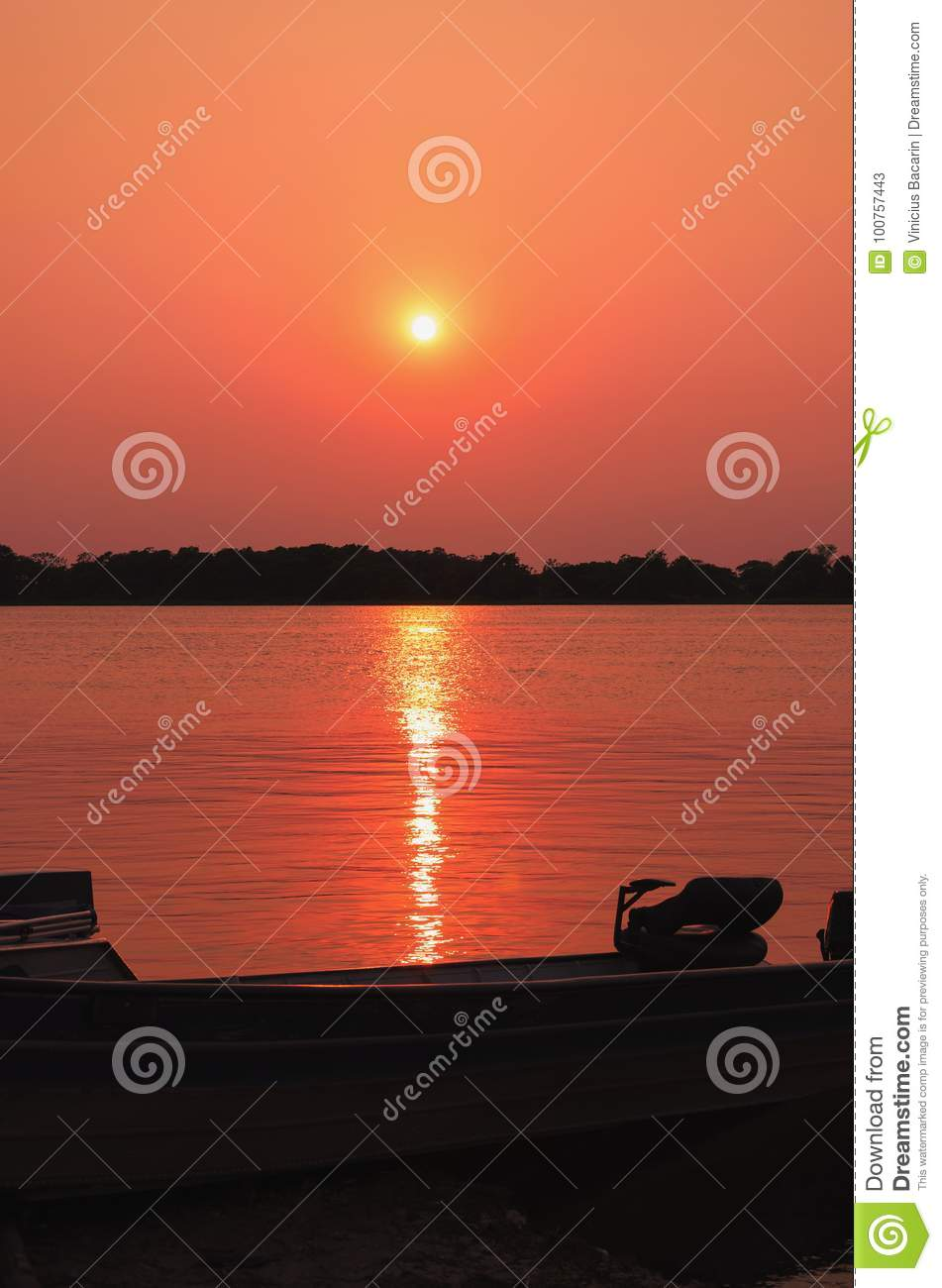 Wonderful landscape of a silhouette of a boat on a amazing sunset