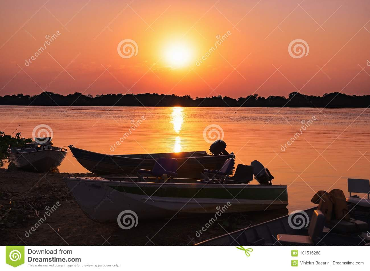 Wonderful landscape of a silhouette of boats on a amazing sunset