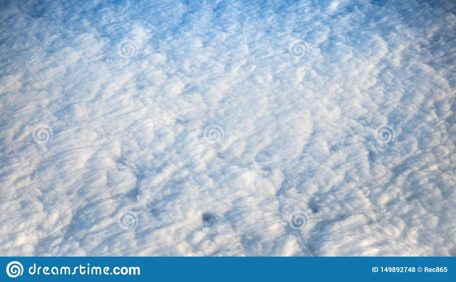 Wonderful view of cloudscape with clear blue sky from above