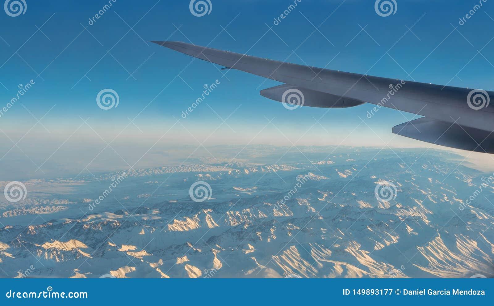 Wonderful View Of Tian Shan Snow Mountains Through Window An Airplane