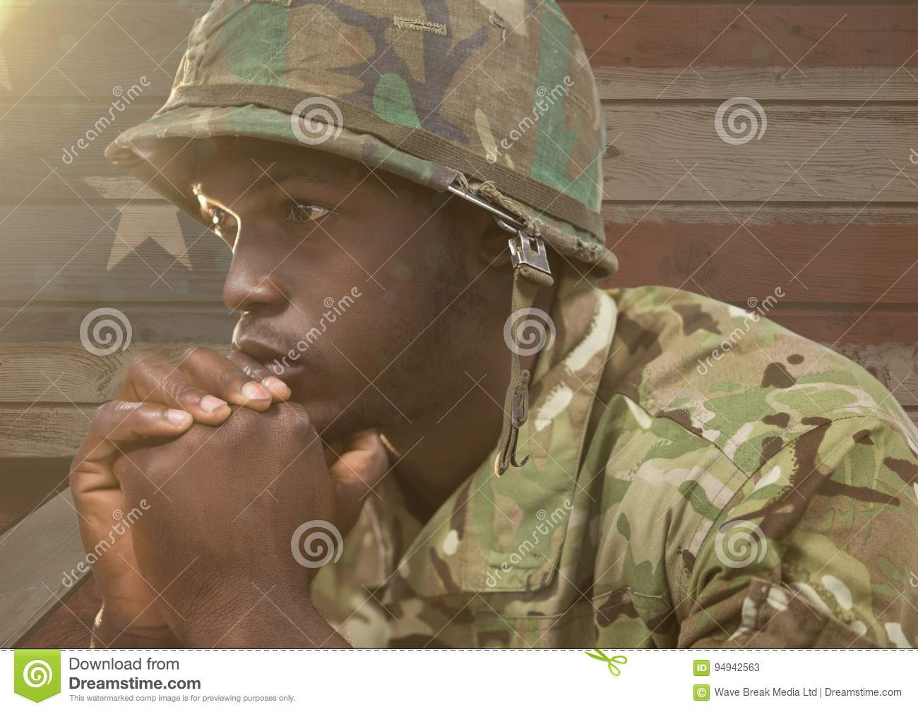 Wondering soldier against a wooden american flag background