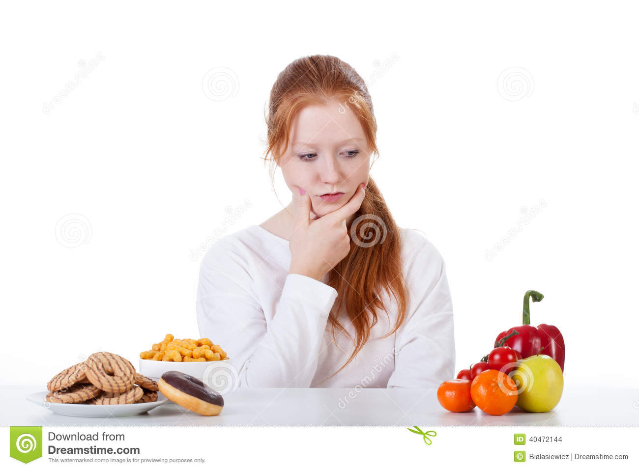 Wondering Whether To Eat Sweets Or Vegetables Stock Photo - Image ...