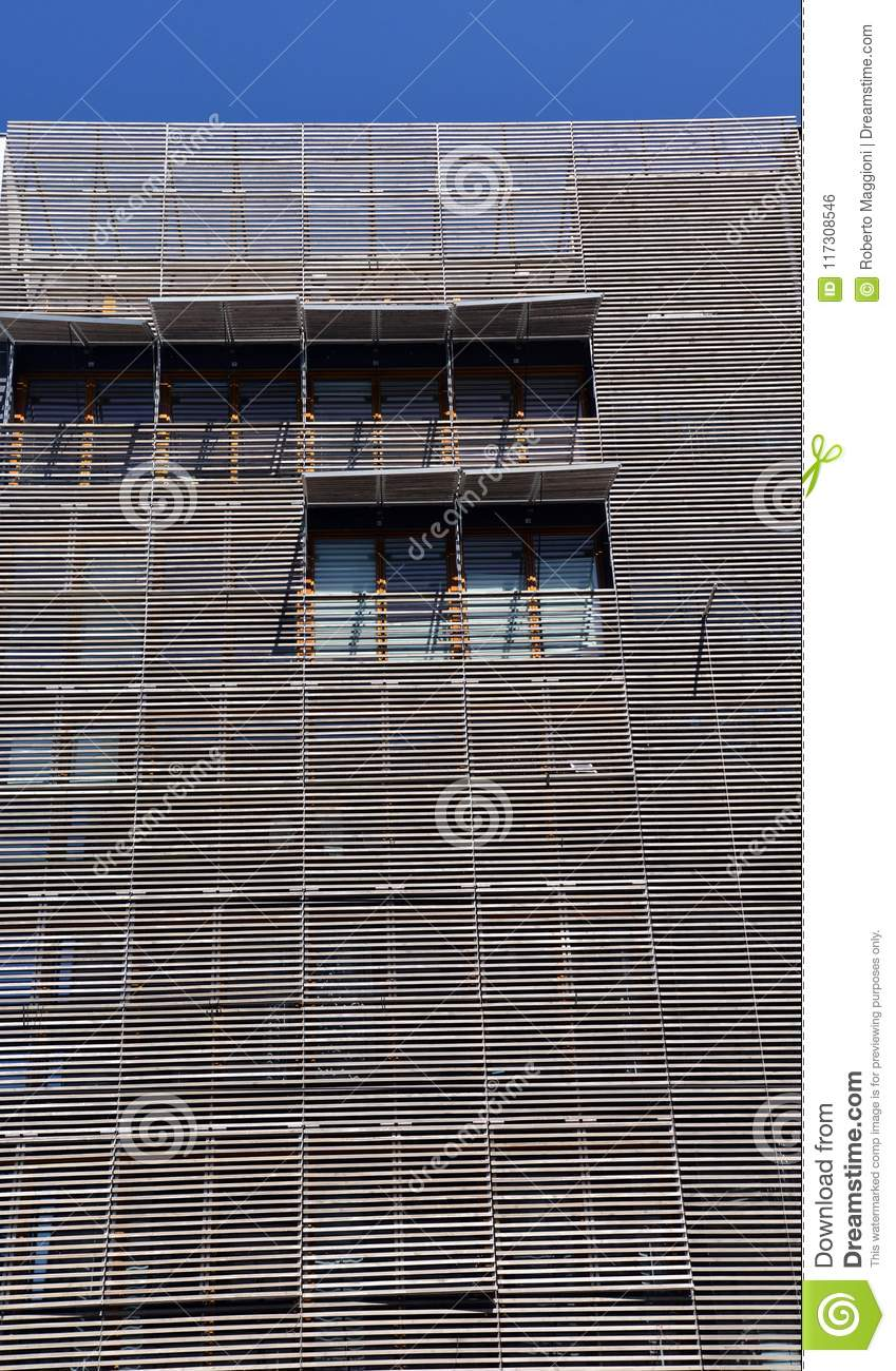Wood battens facade wooden pattern covering of a modern building contemporary architecture