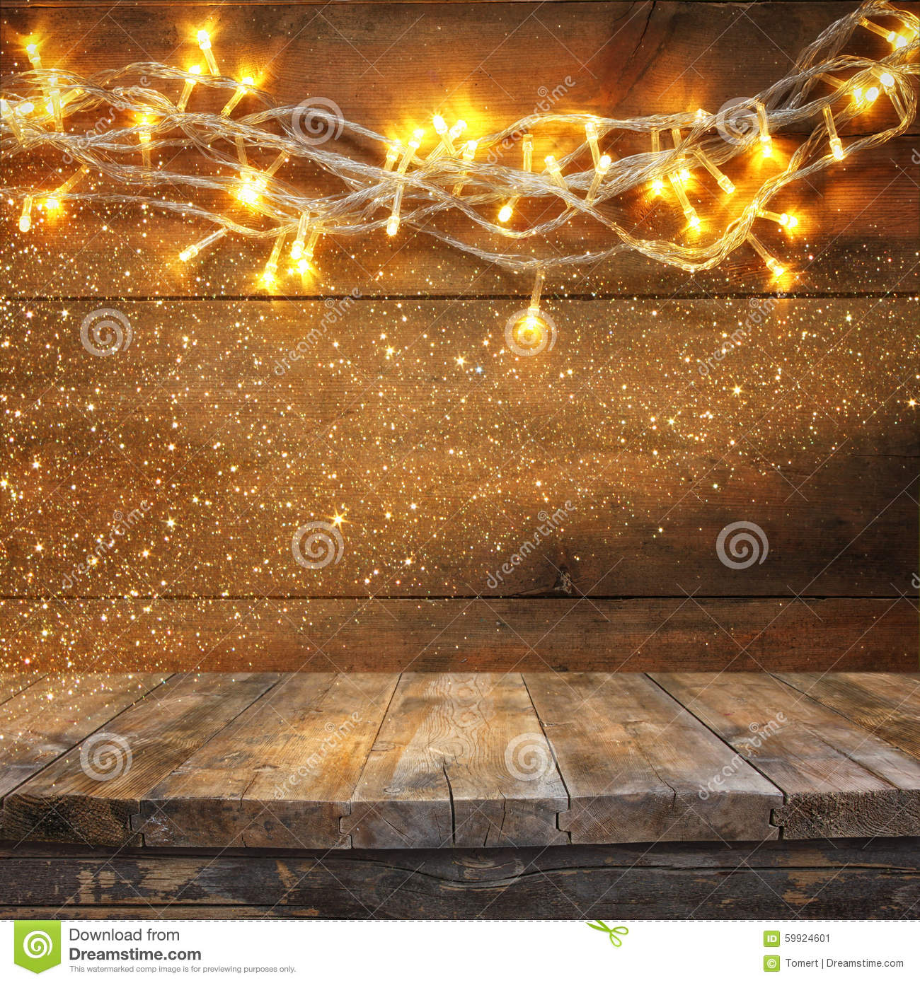 Wood Board Table In Front Of Christmas Warm Gold Garland