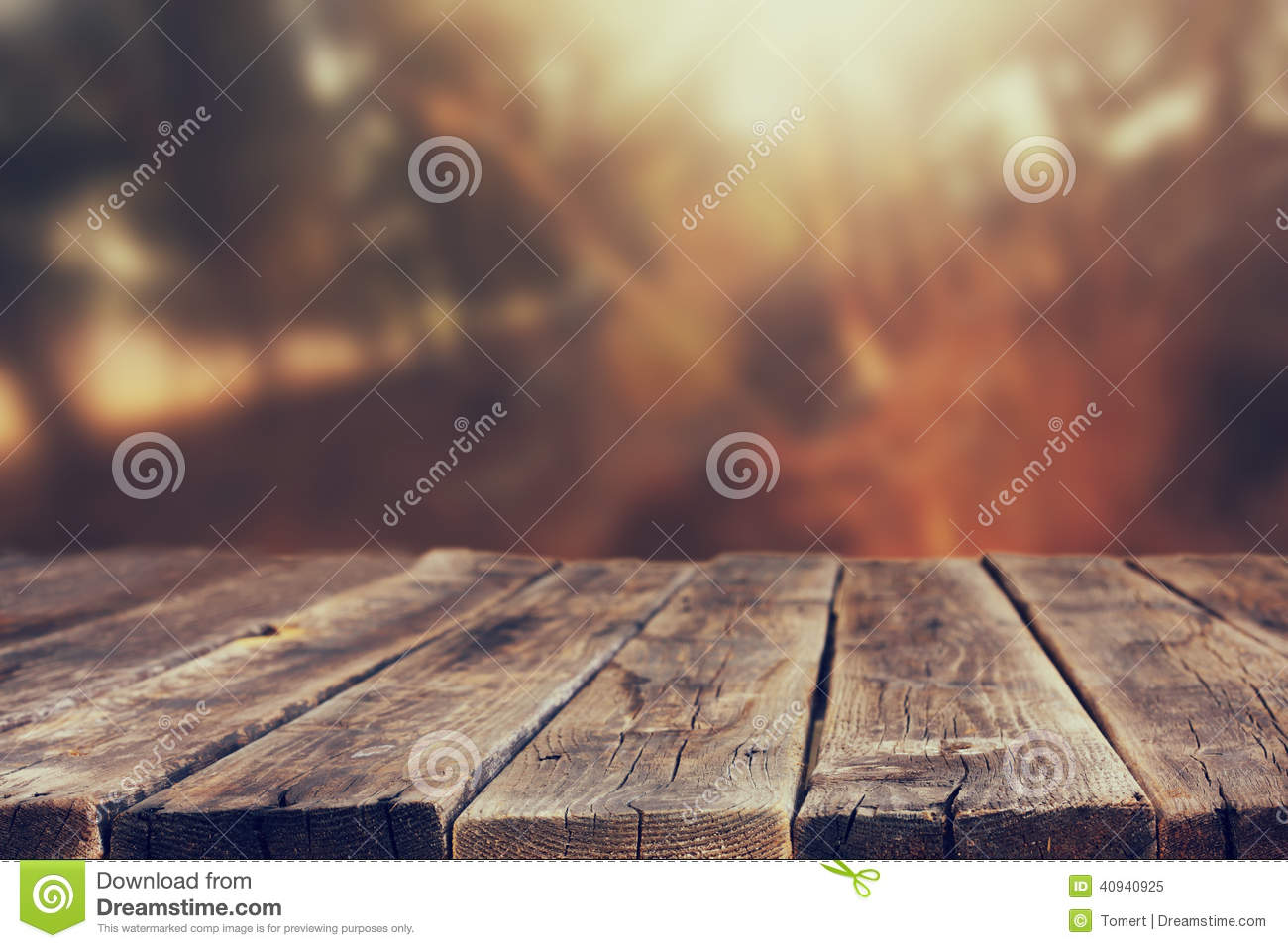 Wood boards and nature backgrounds of summer light among trees