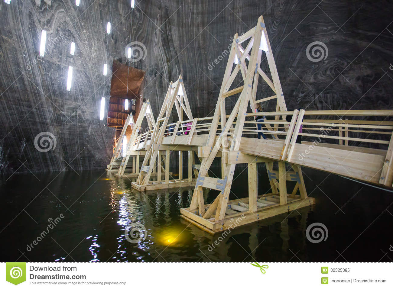 Wood Bridge Over Underground Lake In Turda Salt Mine