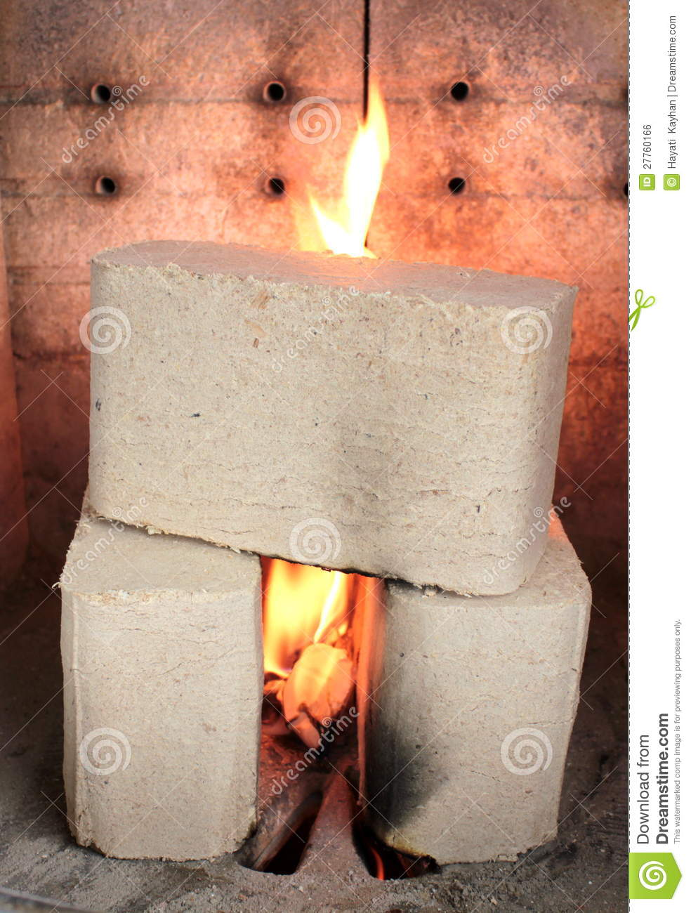 Wood briquettes burning in stove royalty free stock image