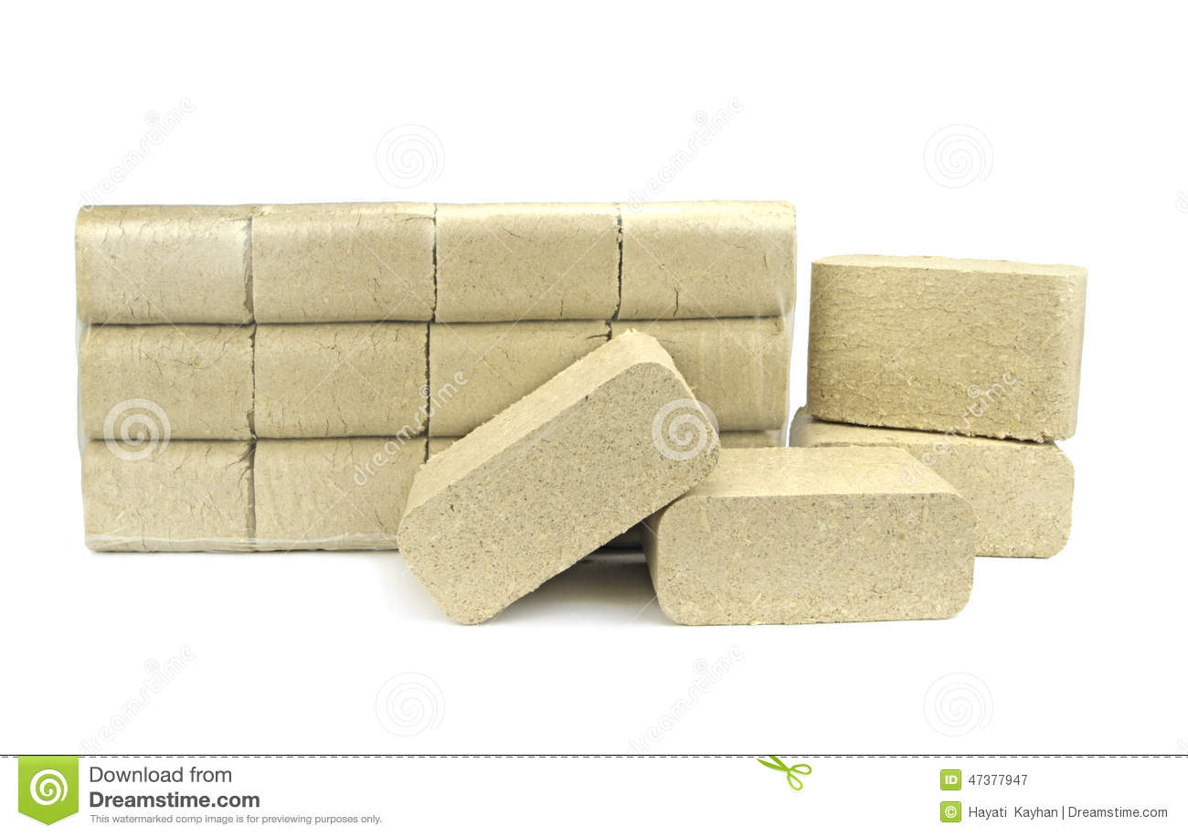 Three wooden briquettes of firewood royalty free stock