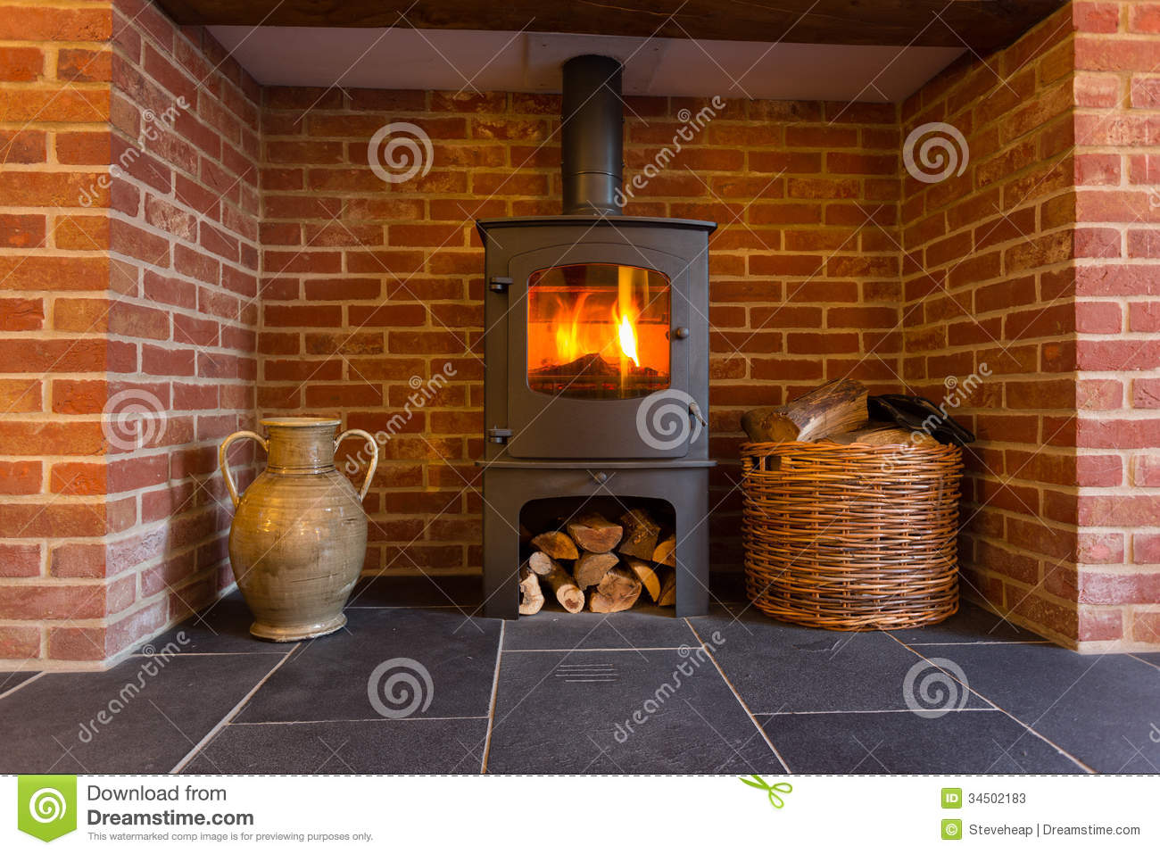 wood burning stove in brick fireplace stock image image 34502183