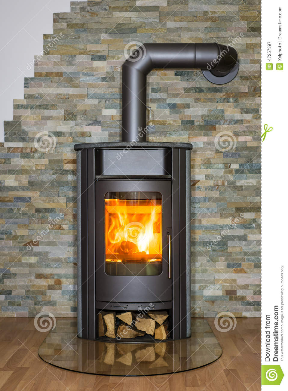 Wood burning stove in house stock image of