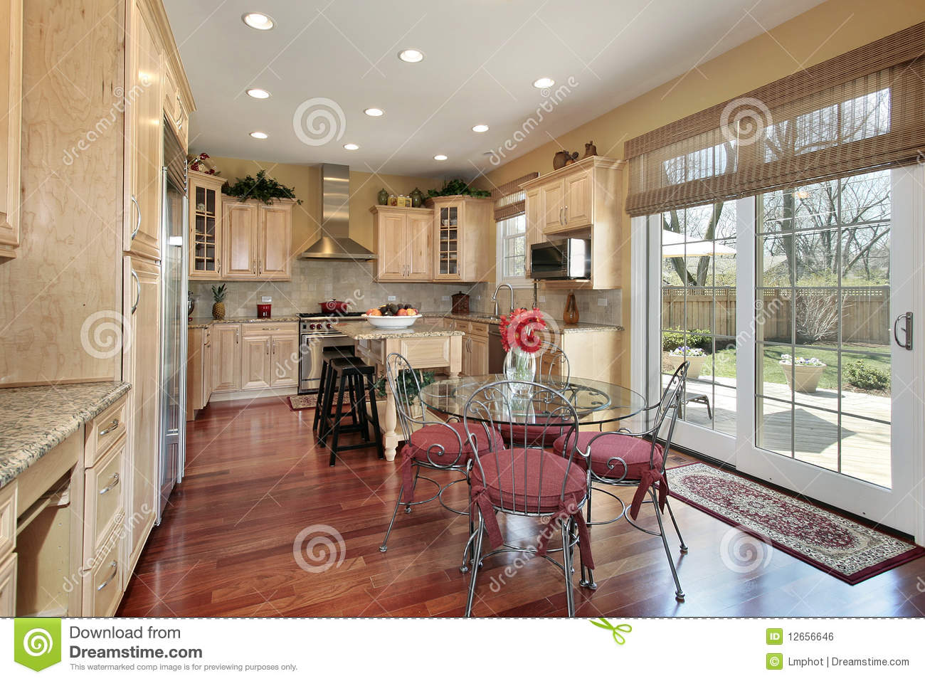 Wood Cabinet Kitchen And Eating Area Royalty Free Stock