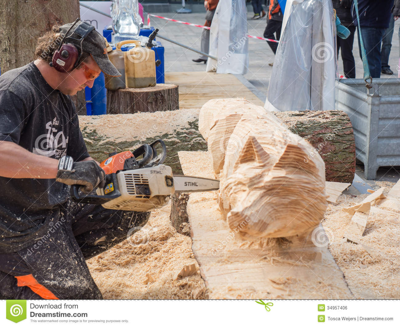 Wood carver at sculpture festival editorial photo image