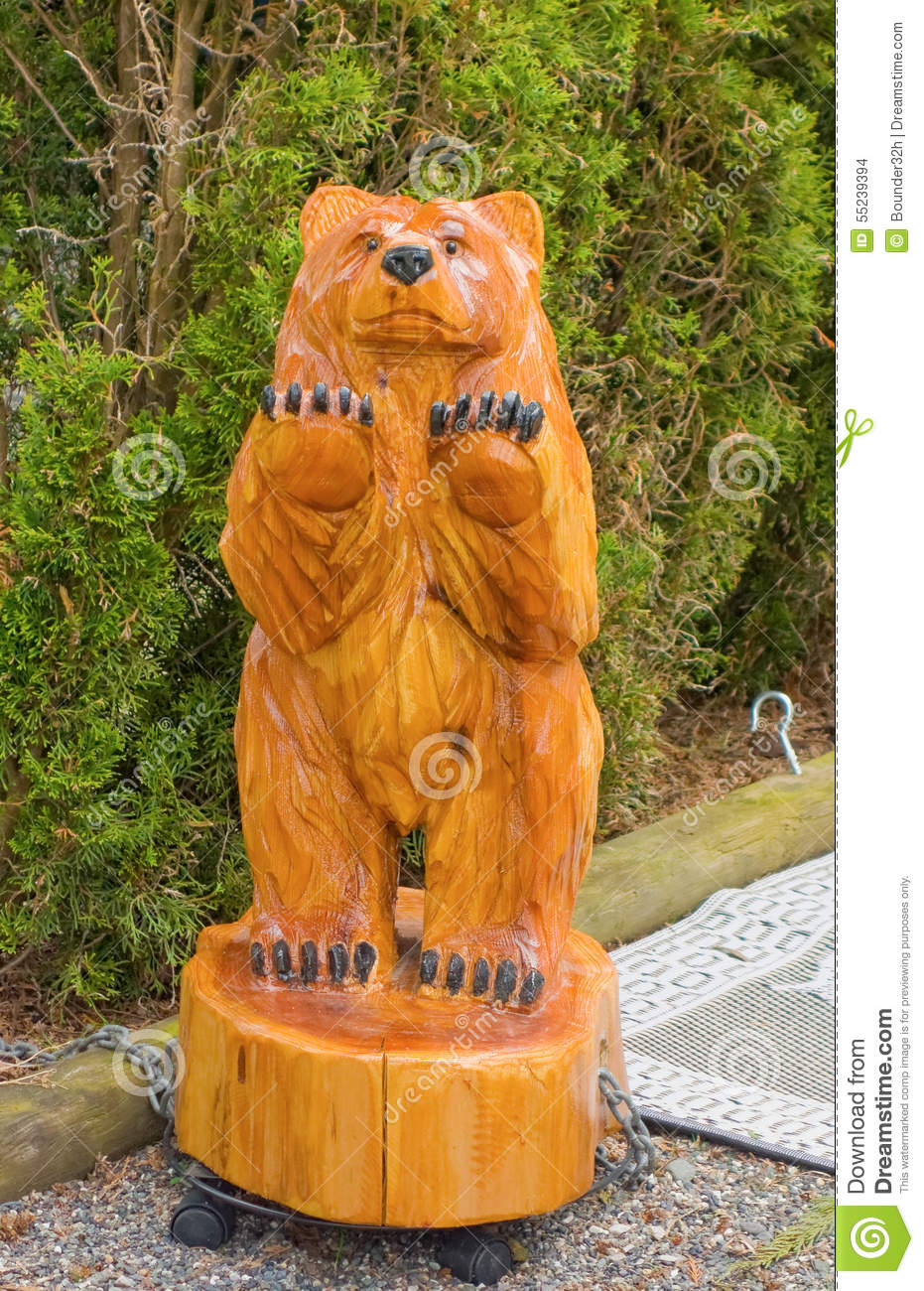 A Wood Carving Of A Bear In British Columbia Stock Photo