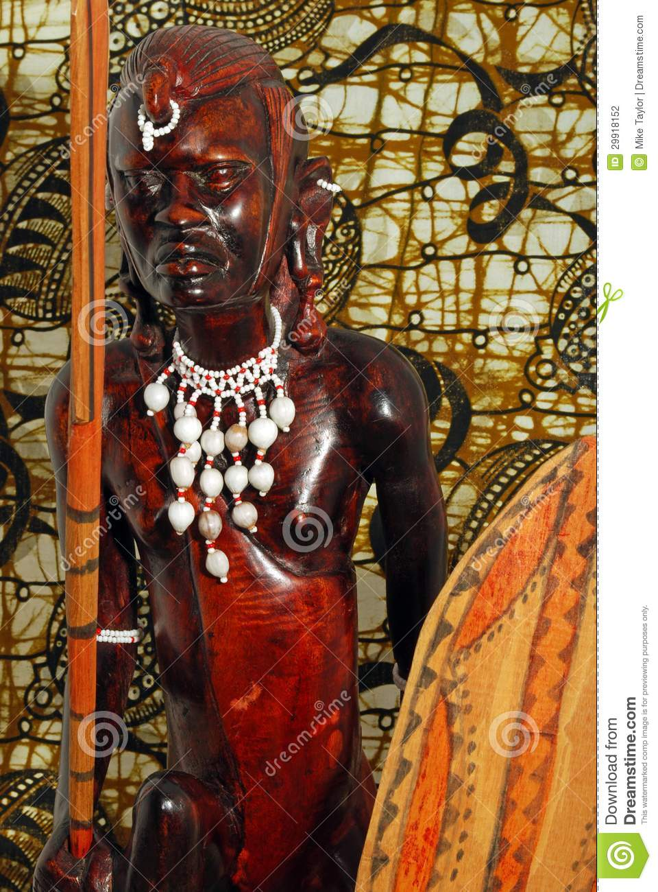 African warrior wood carving stock photo image