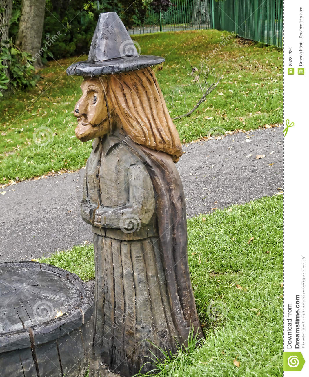 A wood carving of a pendle witch editorial photo image of over