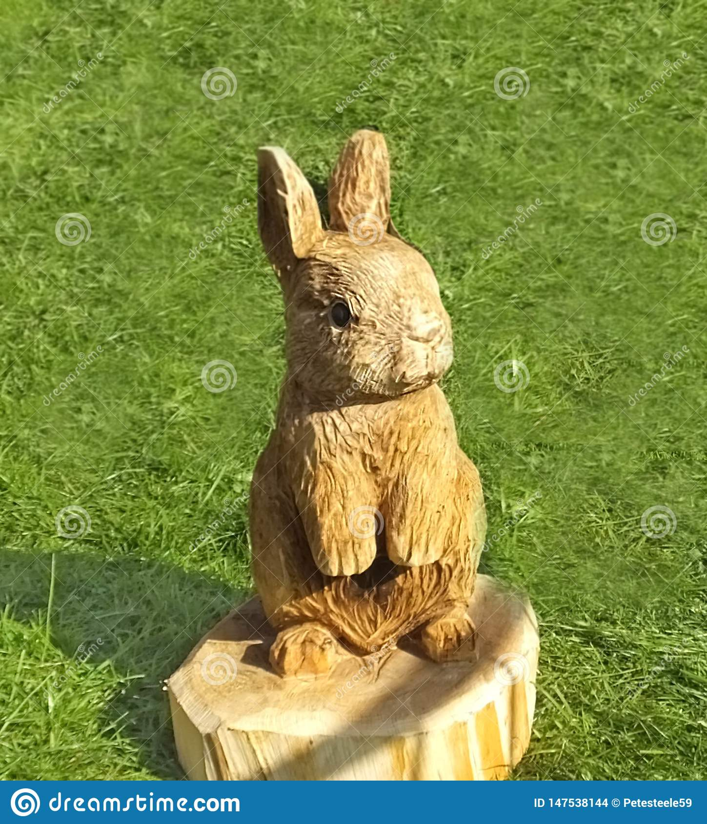 Wood Carving Of A Rabbit In A Garden Woodworking Stock Photo