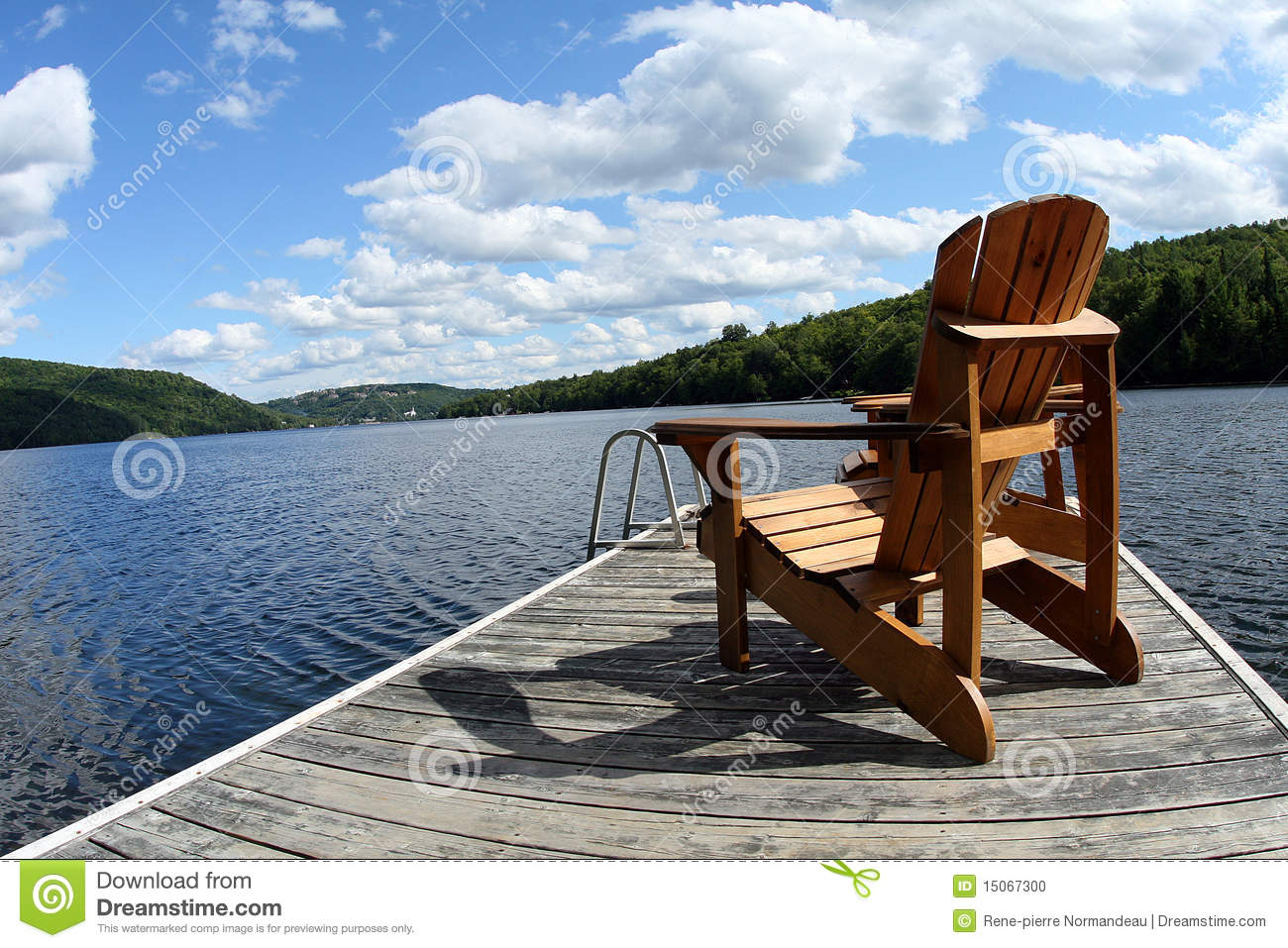 Wood chair on boat deck on the lake