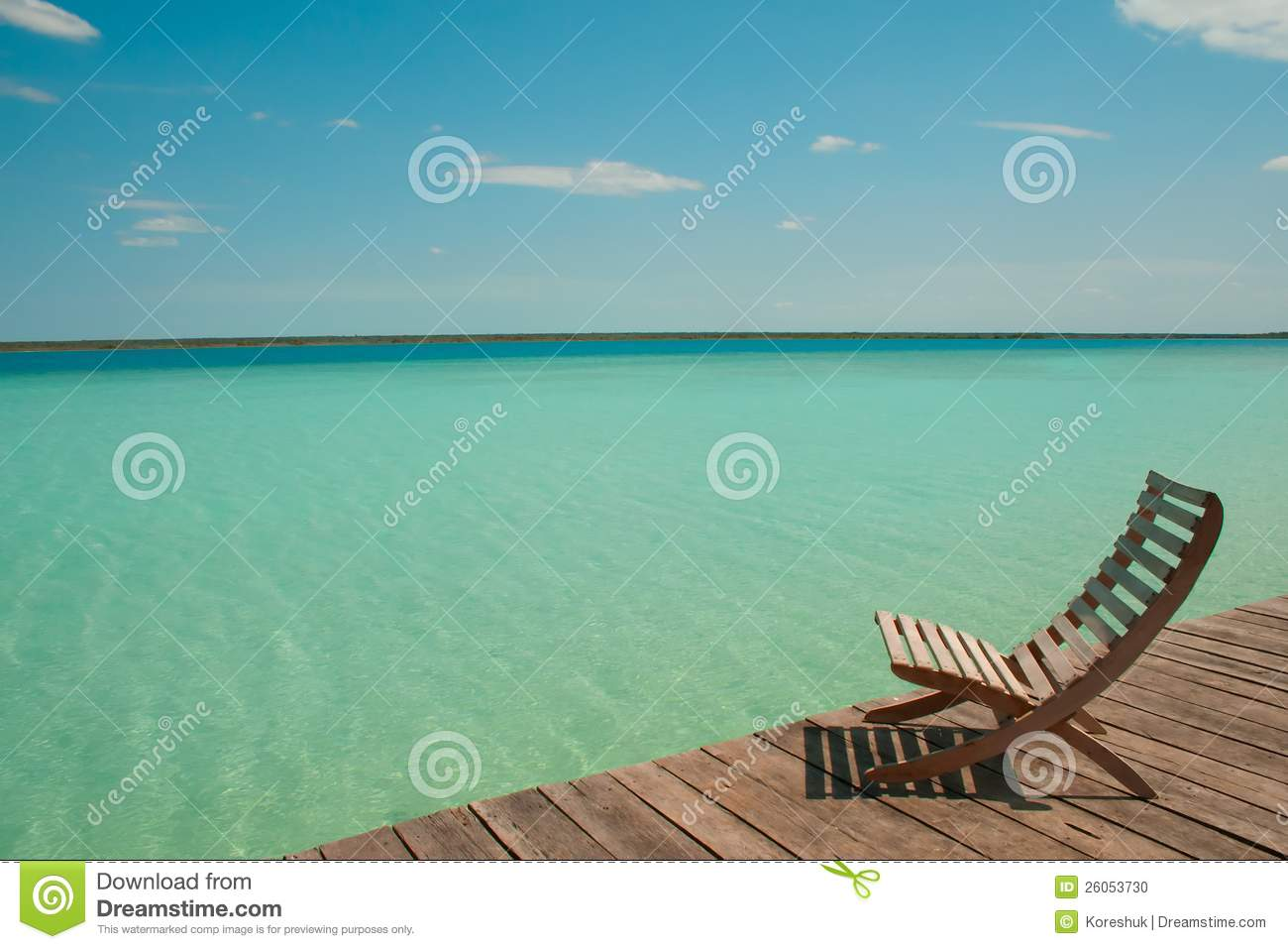 Wood chair facing sea water stock photo image 26053730