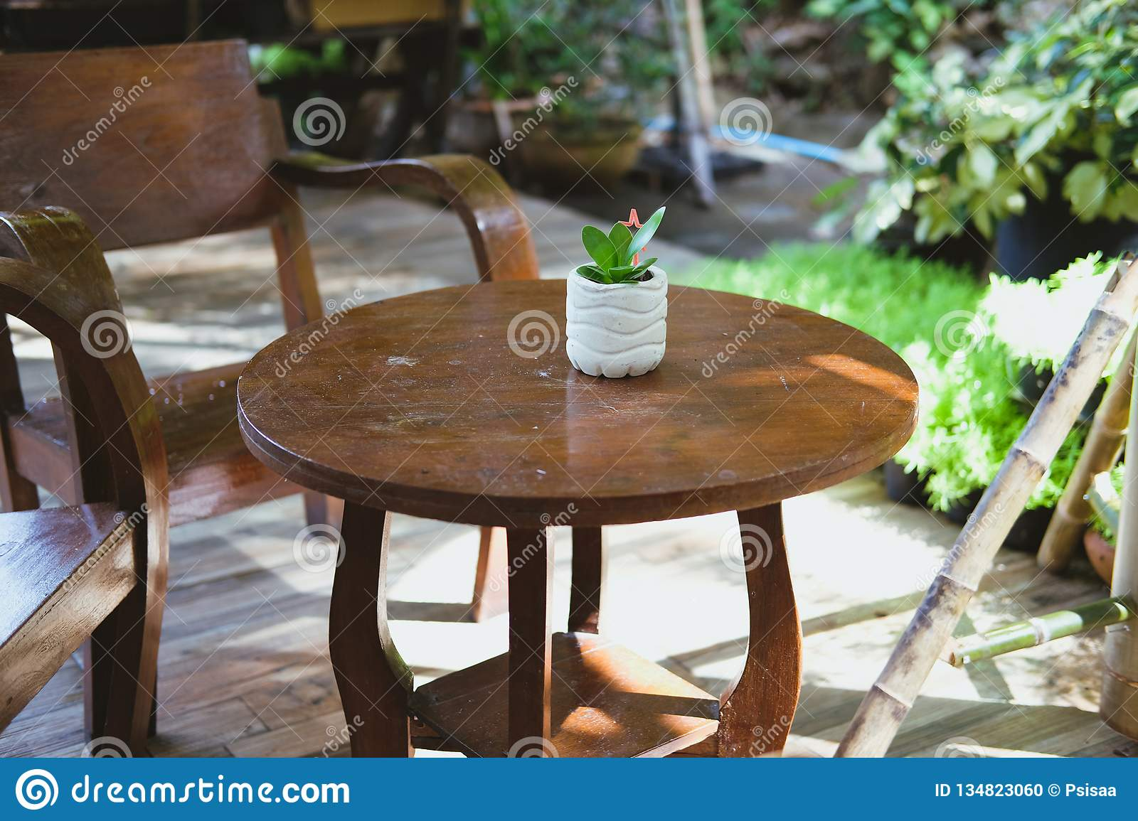 Amazing Wood Chair Table On Terrace Balcony With Garden View Stock Pabps2019 Chair Design Images Pabps2019Com