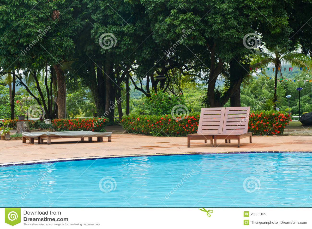 Wood chairs on pool deck