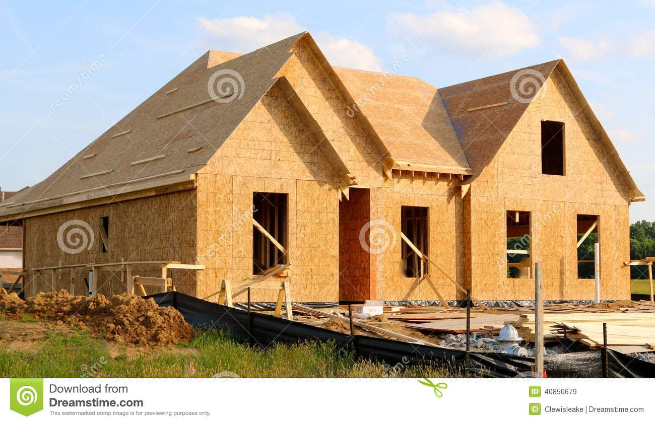Wood Covered Frame Of A Suburban Home Under Construction