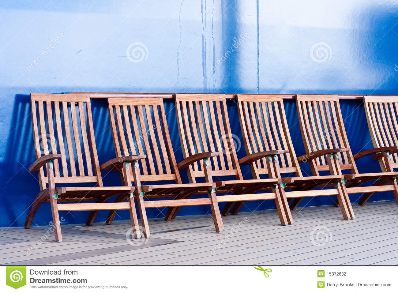 Wooden Deck Chairs Wood deck chairs by a blue