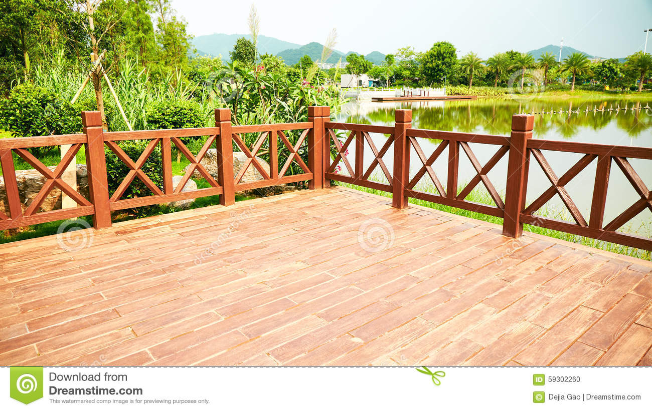 Wood deck wooden patio outdoor stock photo image of deck for Balustrade en verre exterieur
